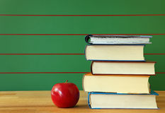 Stack of book and red apple Stock Photography