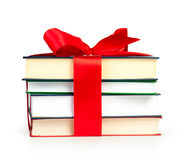 Stack of book with ribbon like a gift Royalty Free Stock Photography