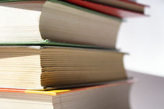 Stack of books. Books of different colors stacked and shot in a closeup stock photo