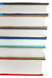 Stack of books. Close up isolated on white Royalty Free Stock Photography