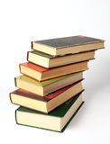 Stack of books. Stack of different sizes of books on white background stock image