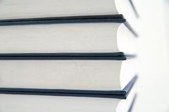 Stack of books. On the white background Royalty Free Stock Image