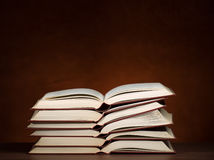 Stack of books. Stack of opened books on the desk, for education,literature or studying themes Royalty Free Stock Photos