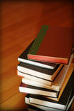 Stack of books. On wooden floor royalty free stock photography
