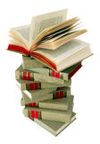 Stack of Books. Stack of grey and red books with top book open stock photo