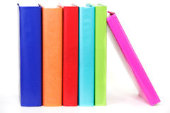 Stack of books. Row of colorful books propped up by one leaning on the end royalty free stock photography