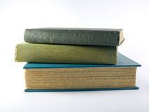 Stack of books. A stack of old books showing aged and worn pages royalty free stock photos