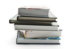 Stack of books. Stack of hardback books isolated on white background Stock Photos