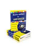 Stack of books. A stack of books with text Euro retten für Anfänger (saving euro for the beginners) with national flags and euro coin cover Royalty Free Stock Photos