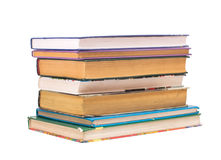 Stack of books. A stack of books of various sizes on a white background Stock Image