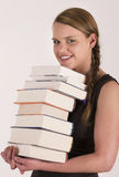 Stack of books. Pretty girl carrying a stack of books Royalty Free Stock Photos
