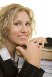 Stack of books. Blonde woman leaning her head on a stack of books royalty free stock photo