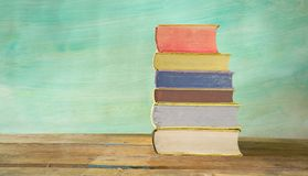 Stack of books against grungy background, Royalty Free Stock Photography