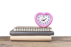 Stack of books and an alarm clock Stock Photography
