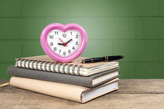 Stack of books and an alarm clock Royalty Free Stock Images