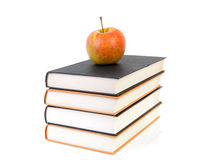 Stack of books with apple Royalty Free Stock Image