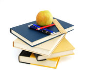 Stack of books with apple Stock Photo