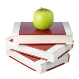A stack of books and an apple. Royalty Free Stock Photos