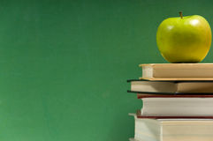 Stack of books with apple Stock Images