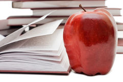 Stack of books and apple isolated Royalty Free Stock Photo