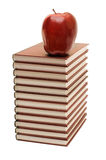 Stack of books and apple isolated stock images