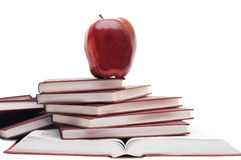 Stack of books and apple isolated stock image