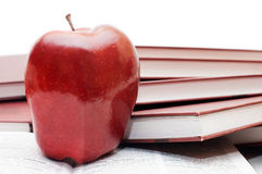 Stack of books and apple isolated Stock Photo