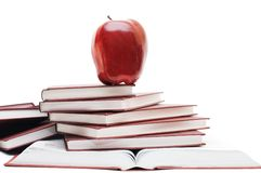 Stack of books and apple isolated Royalty Free Stock Photos