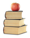 Stack of books and apple isolated on white Royalty Free Stock Photos