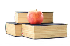 Stack of books and apple isolated on white Royalty Free Stock Photo