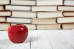 Stack of books and apple on the table. Copy space for text. Selective focus. Knowledge concept Royalty Free Stock Photo