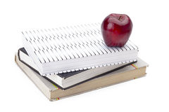 Stack of books with an apple on top Royalty Free Stock Photo
