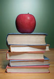Stack of books with apple Royalty Free Stock Photo