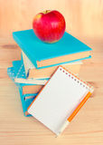Stack of books with apple on top.Background. Stock Photos