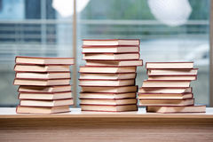 The stack of books arranged the office desk. Stack of books arranged the office desk stock images