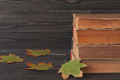Stack of books with autumn maple leaves Royalty Free Stock Image