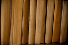 Stack of books background. many books piles.Old antique books background. Antique manuscripts.Book Background.vintage Stock Image