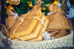 Stack of books in basket. A stack of books in a basket next to a Christmas tree Royalty Free Stock Photo