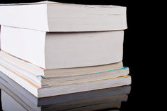Stack of books on black Royalty Free Stock Photography