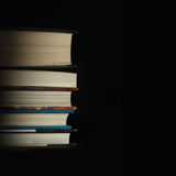 Stack of books on the black background Royalty Free Stock Photo