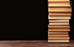 Stack of books on a black  background.Education. Image stock photos