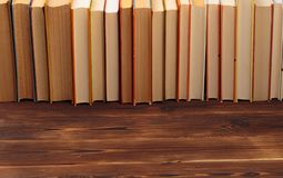 Stack of books on a black  background.Education. Image royalty free stock photo