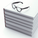 Stack of books with black glasses Royalty Free Stock Image