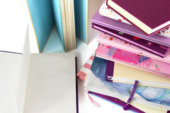 Stack of books and blank page on open book. Royalty Free Stock Image
