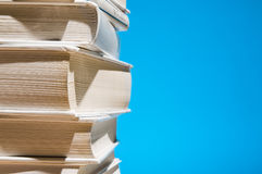 Stack of books on blue Stock Image