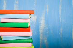 Stack of books on a blue background. Royalty Free Stock Image