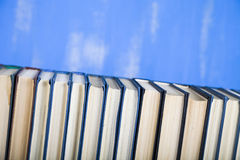 Stack of books on a blue background. Royalty Free Stock Photography