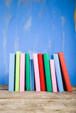 Stack of books on a blue background. Stock Photography