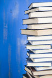 Stack of books on a blue background. Royalty Free Stock Images