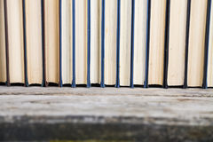 Stack of books on a blue background. Royalty Free Stock Photos